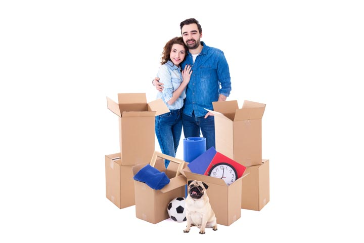Moving Day Concept - Young Couple With Brown Cardboard Boxes And